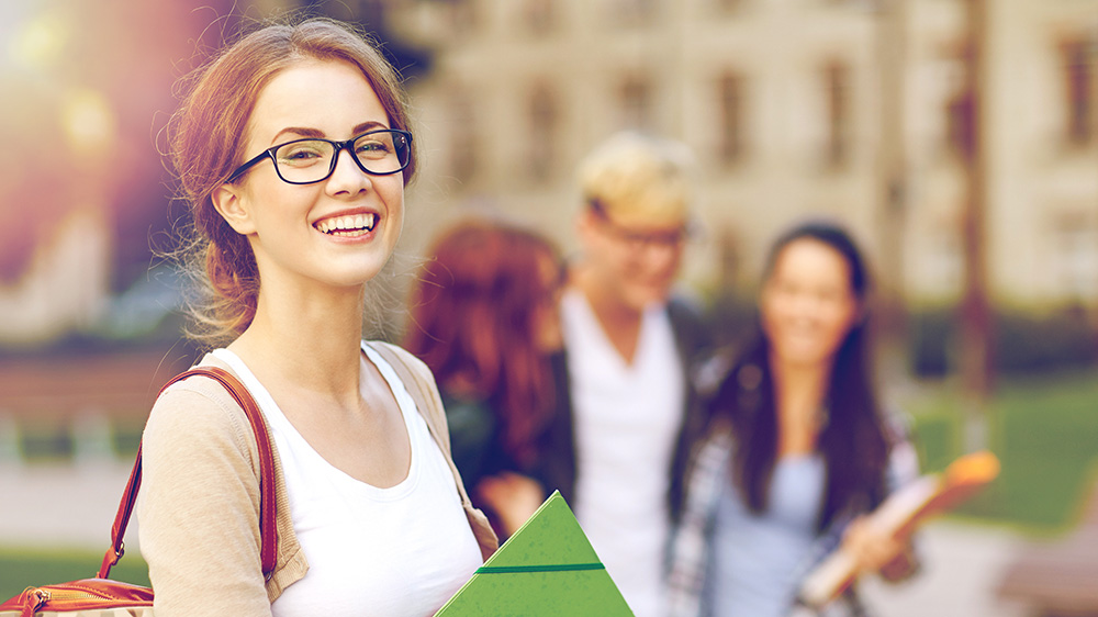 A student on a collge campus.