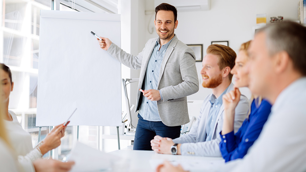 A male leading a group.