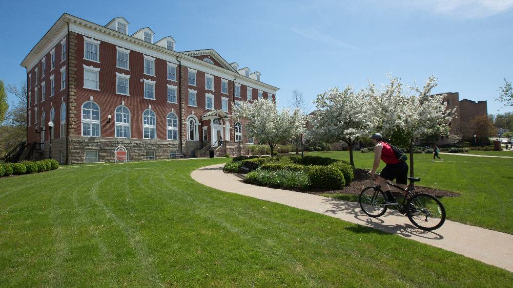 A Cal U student rides his bike on campus.