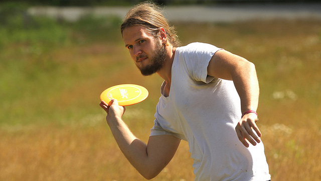 A Cal U student plays frisbee golf on the SAI Farm.
